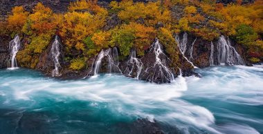 The Hraunfossar is a series of waterfalls in the West of Iceland. They seem to come out of nowhere, pouring through the lava along a stretch of hundreds of meters. I photographed them in autumn 2013, at the moment the colours were at their peak. I decided for a panorama photo because it did most justice to the falls; I took 3 pcitures with a tilt shift lens (24 TSE 3.5 ii from Canon) and I stitched them together in Photoshop.